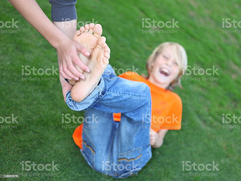 Tickling young feet